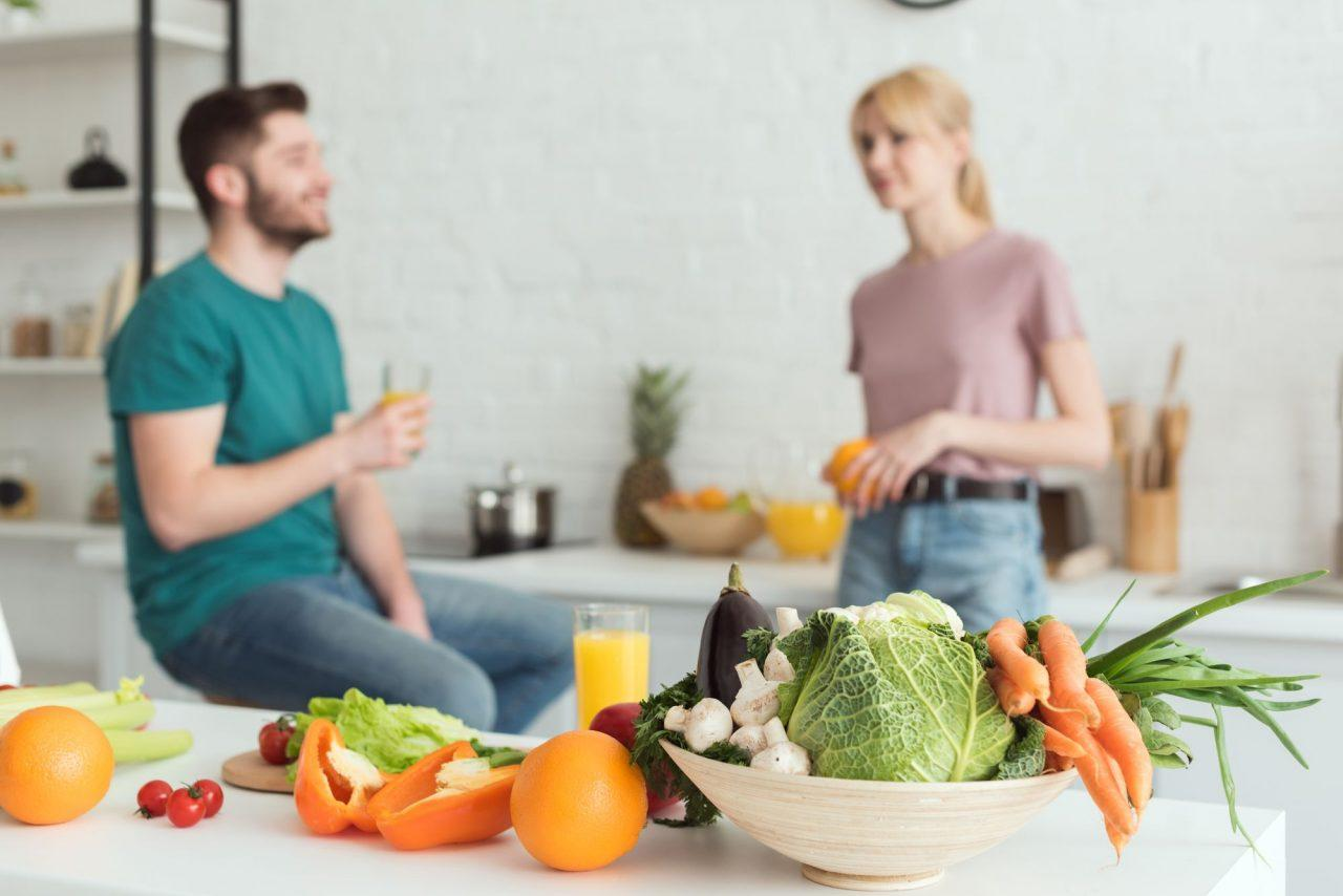 A couple eating vegetables