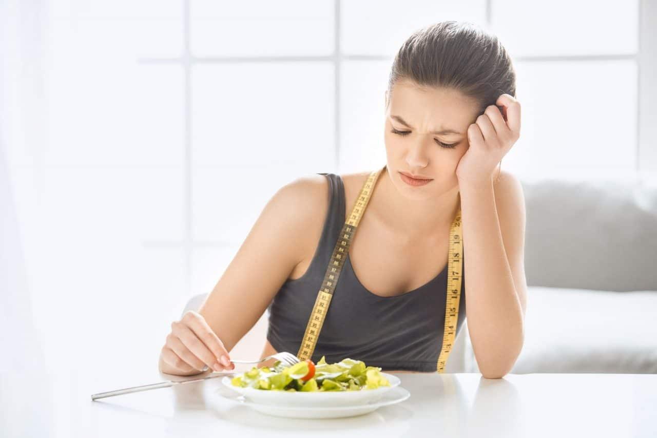 Upset girl eating vegetables