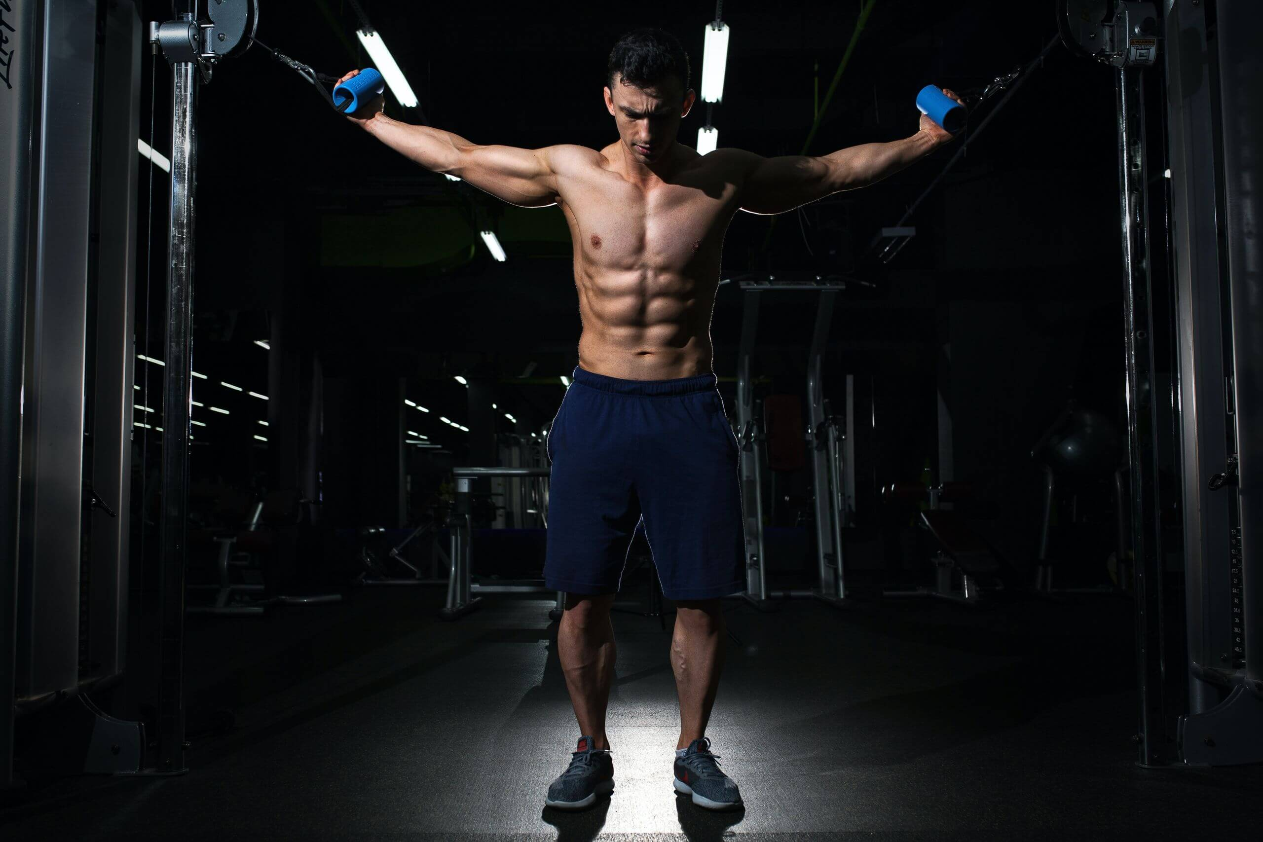 Man is training chest on crossover machine
