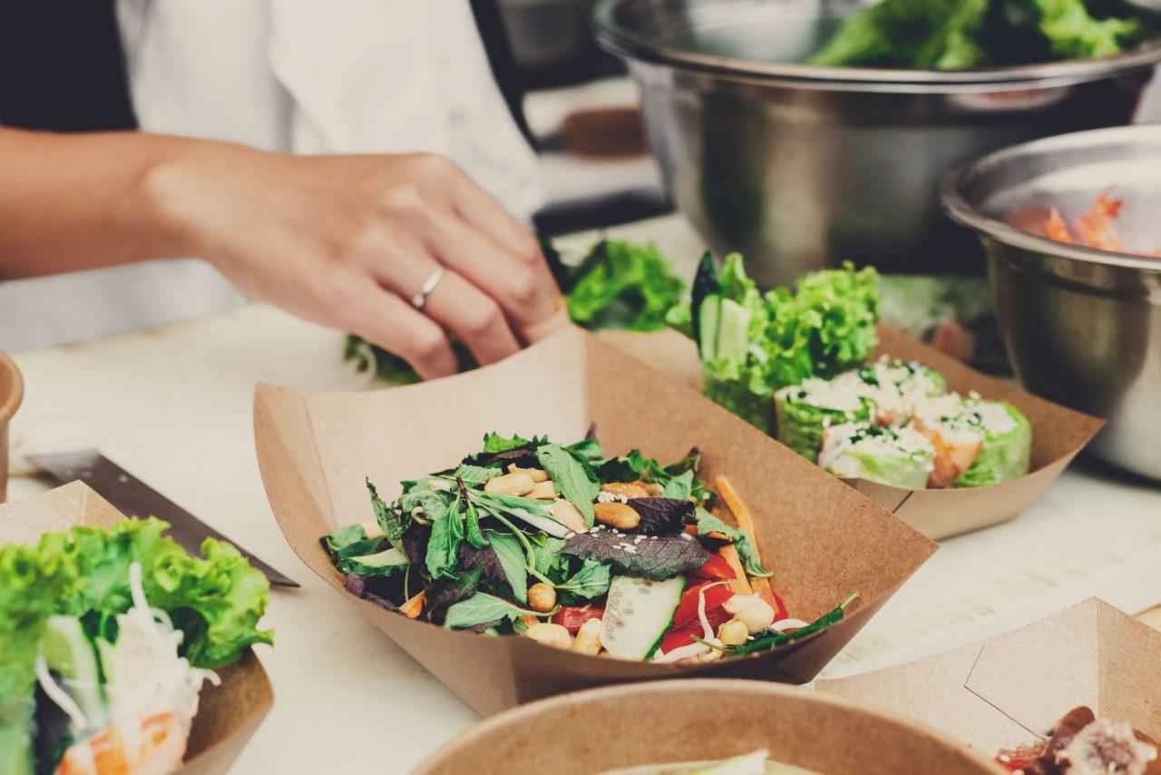 Vegetable salads in kraft paper plates sold outdoors at local market place
