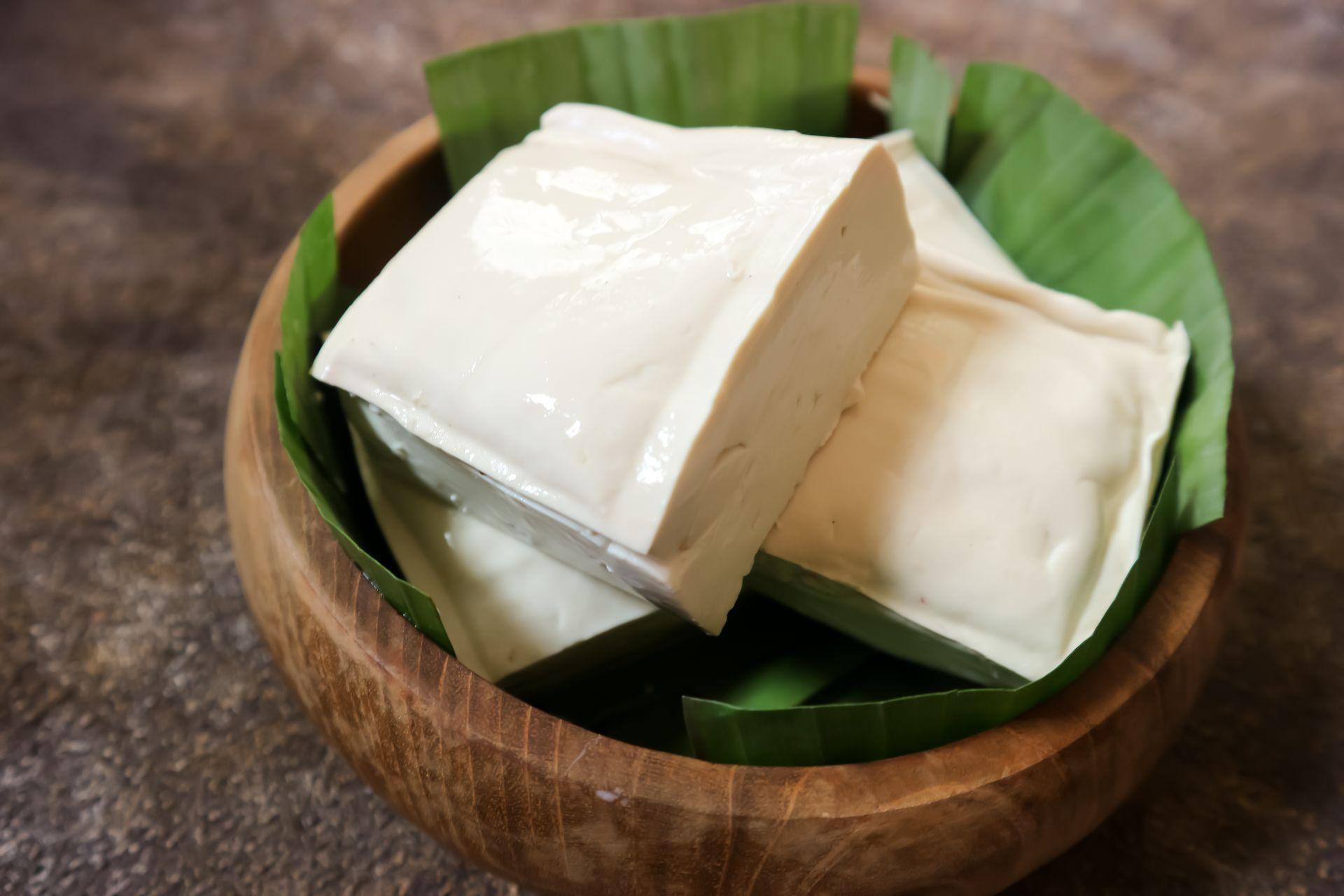 Tofu is a food made from coagulated soybean seed presses